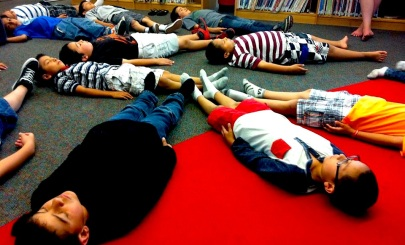 Elementary school students practicing relaxation techniques in a Calming Kids class in Longmont.