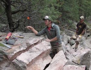 JB Haabs (left) discusses the proper method of breaking rocks to make into  trail steps, while Aaron Mojica watches in the background on Friday Oct. 24, 2014. The Front Range Climbing Stewards began work on the Royal Arch Trail in Boulder, Colorado in August.