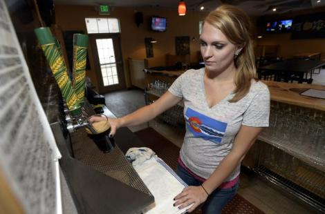 Employee pours beer at Echo Brewing. Photo credit: Jeremy Papasso, Boulder Daily Camera
