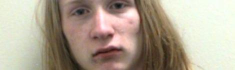 Long-haired teenage criminal