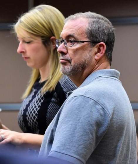 White male with salt and pepper beard in court